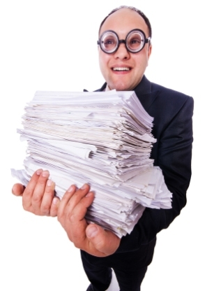 bigstock-Funny-man-with-lots-of-folders-45672487